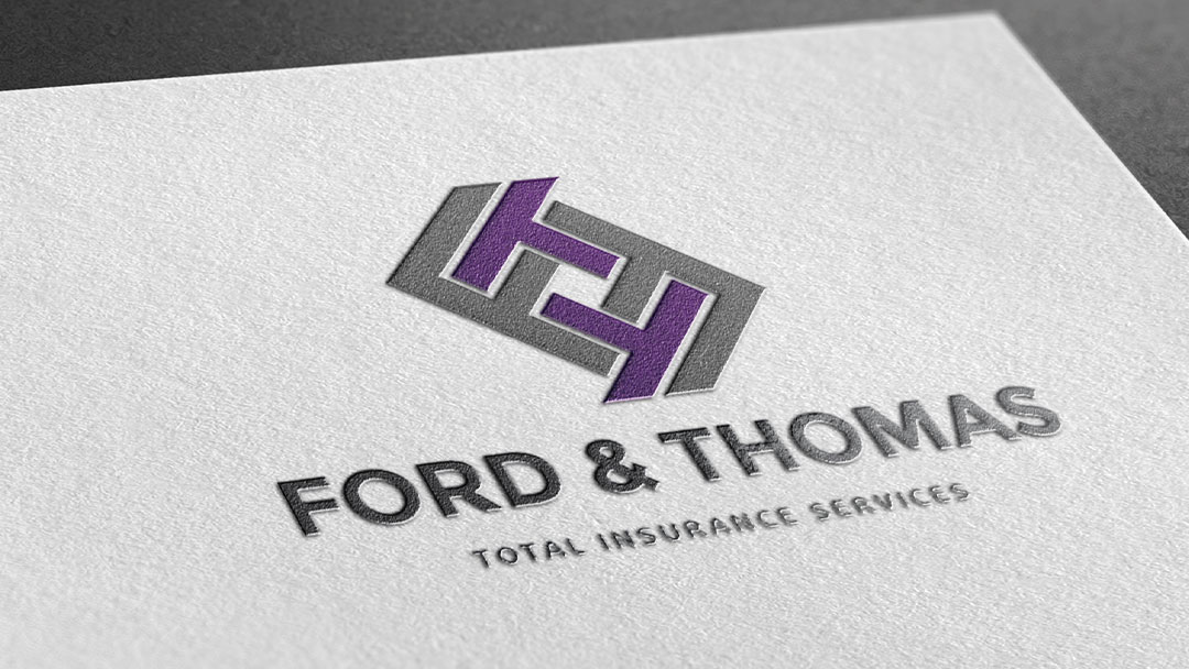 Mockup of logo on paper for Ford and Thomas